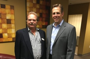 Jeffrey Barnhart, CEO and president of CMA, and Robert Hogg, executive director of Ancero at the wine tasting to benefit Trenton Digital Initiative at the IT consulting company's office in Mount Laurel.